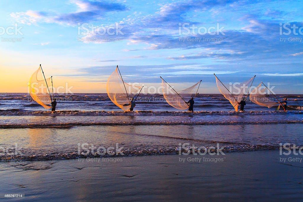 Fishermen using fishing gear in ocean in Nam Dinh, Vietnam stock photo