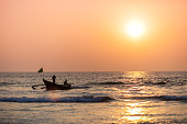 Fishermen coming back from the sea with catch in Goa, India