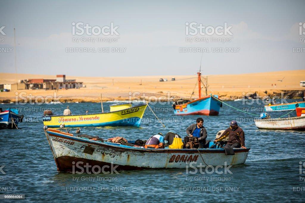 Fishermen working at Paracas national park. stock photo