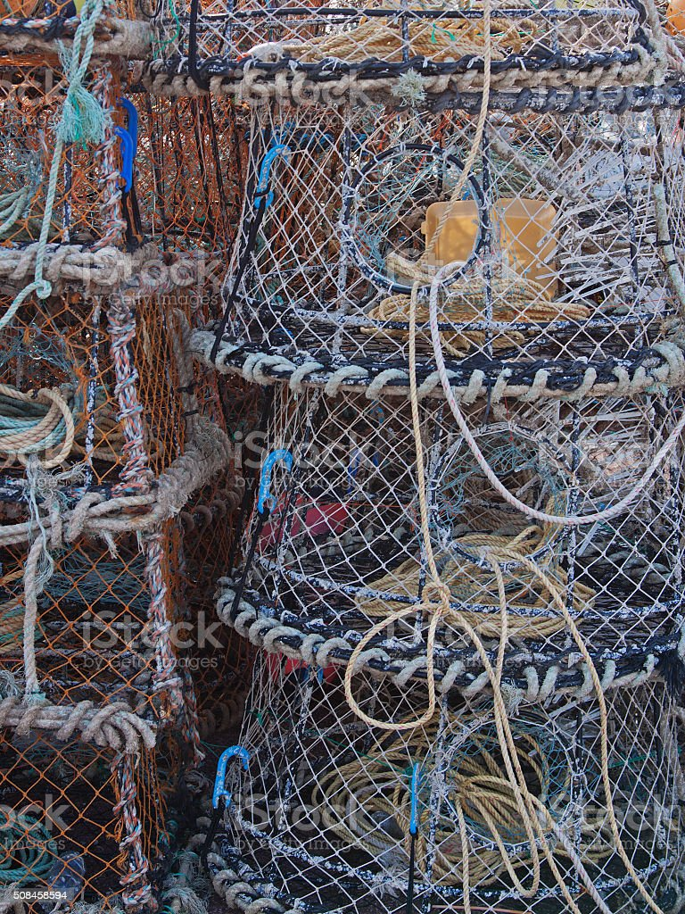 Fishermen's creels stacked on a UK quayside stock photo