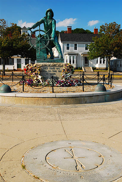 Fishermen's Memorial, Gloucester The famed Fishermen's Memorial in Gloucester Massachusetts honors the many fishermen who were lost at sea  gloucester massachusetts stock pictures, royalty-free photos & images