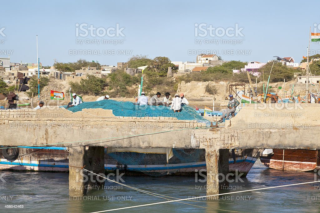 Fishermens nets being mended at Bet Dwarka royalty-free stock photo