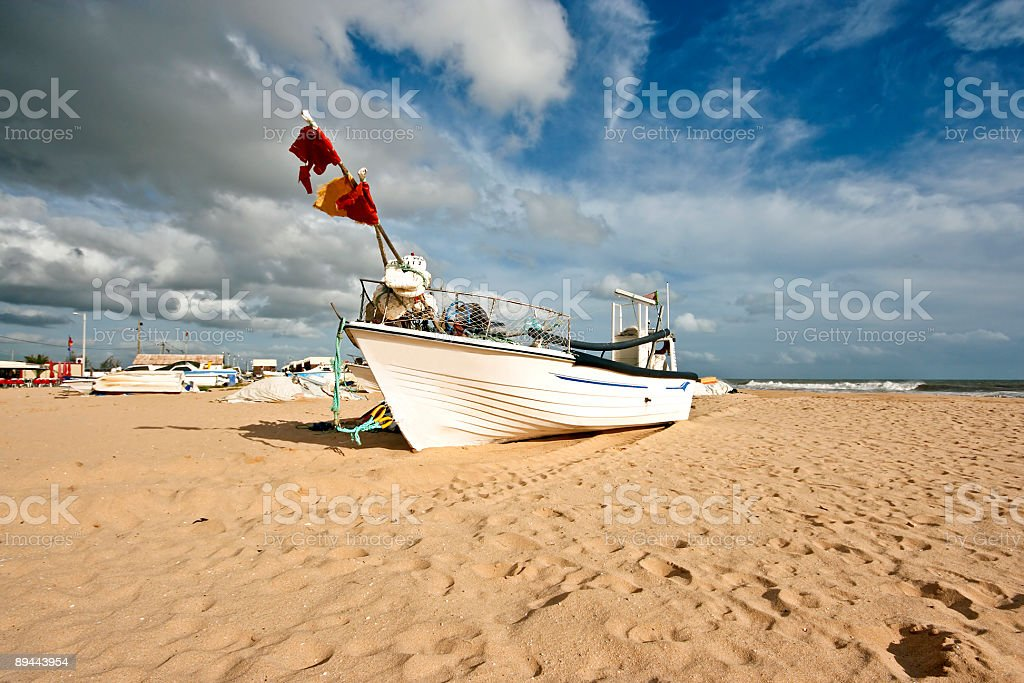 Fishersboat on the beach at Armacao de Pera in Portugal royalty-free stock photo