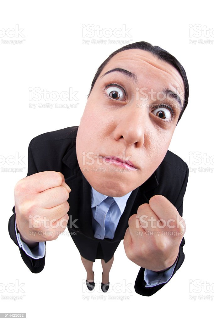Fisheye angry businesswoman shrinks fists to fight stock photo