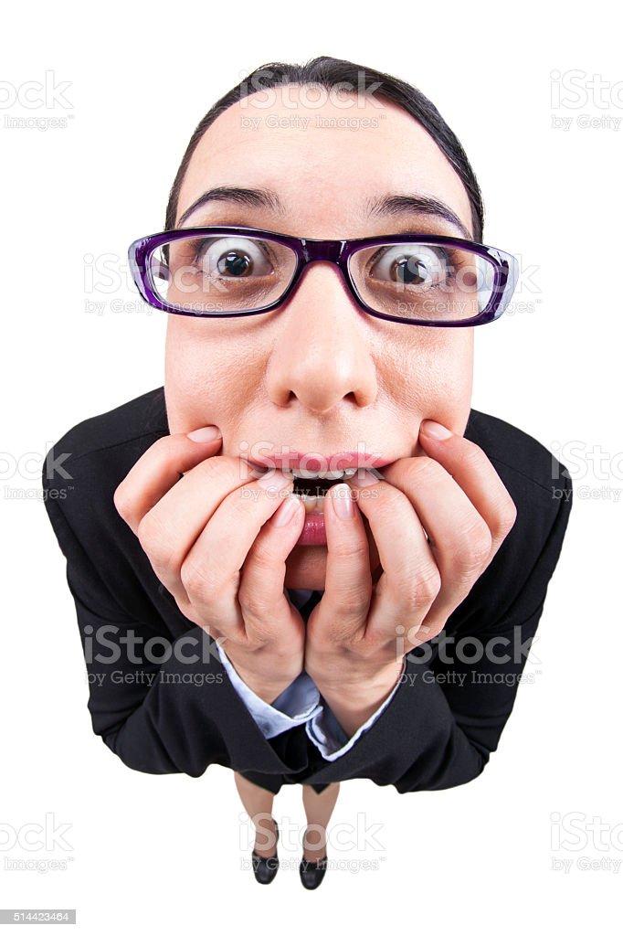 Fisheye businesswoman biting her nails. stock photo
