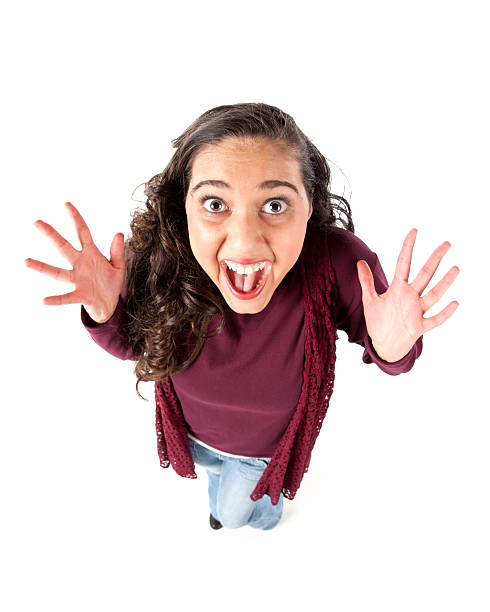Fisheye Caricature of an Elated Teenage Girl A humorous fisheye caricature of an elated teenage girl celebrating success. fish eye lens stock pictures, royalty-free photos & images