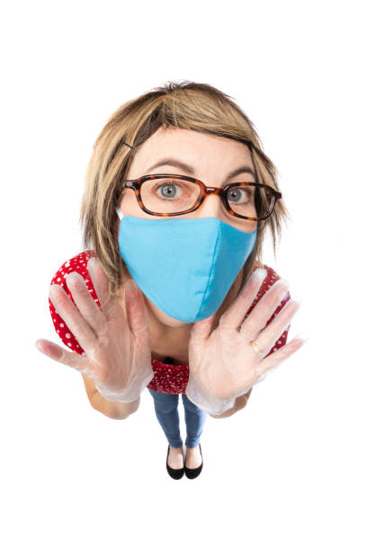 fisheye funny woman in face mask and gloves - sdominick stock pictures, royalty-free photos & images