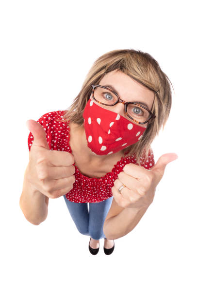 fisheye funny woman in face mask giving thumbs up - sdominick stock pictures, royalty-free photos & images