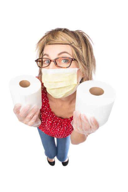 fisheye funny woman in face mask holding toilet paper - sdominick stock pictures, royalty-free photos & images
