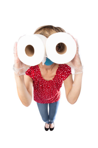 fisheye funny woman in face mask making toilet paper binoculars - sdominick stock pictures, royalty-free photos & images