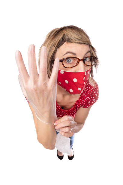 fisheye funny woman in face mask putting gloves on - sdominick stock pictures, royalty-free photos & images