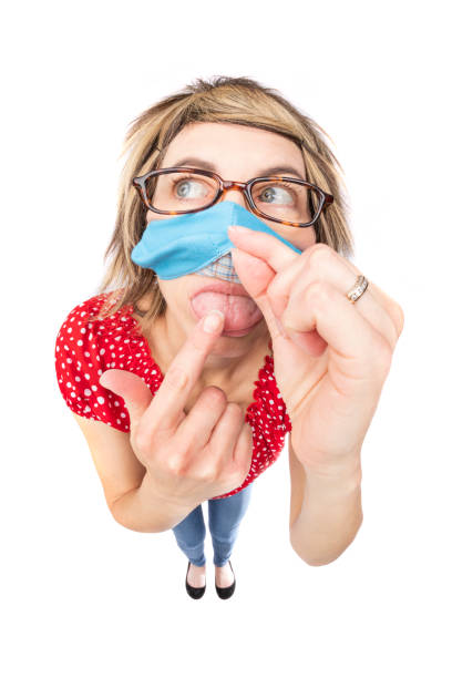fisheye funny woman lifting face mask to lick finger - sdominick stock pictures, royalty-free photos & images