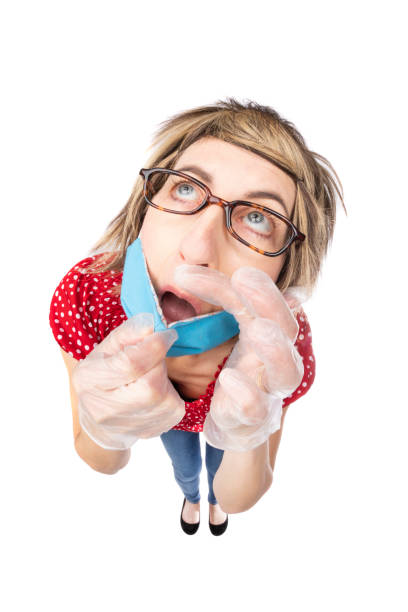 fisheye funny woman pulling mask off to touch face - sdominick stock pictures, royalty-free photos & images