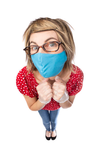 fisheye funny woman wearing face mask and gloves - sdominick stock pictures, royalty-free photos & images