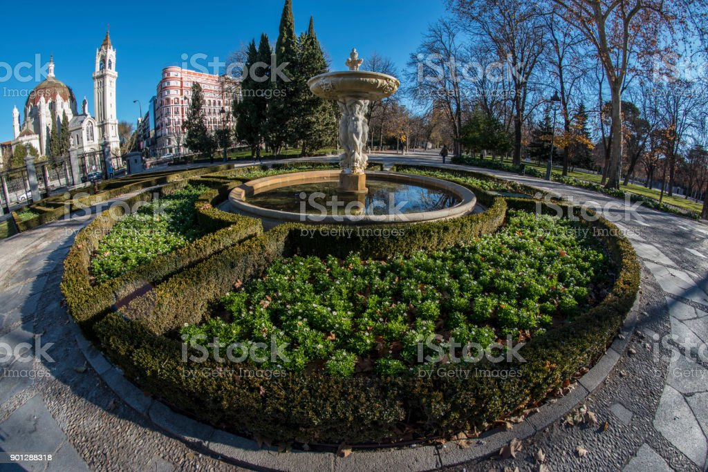 Fish-eye view 180 of a fountain in the Retiro park in Madrid city