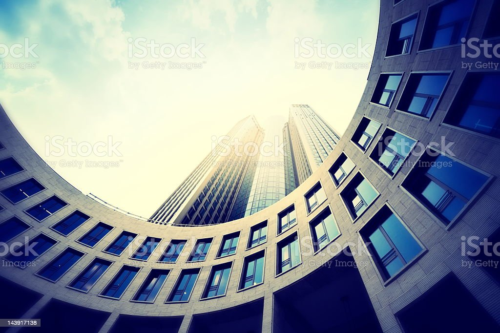 Fisheye view of a modern office building against a sunny sky royalty-free stock photo