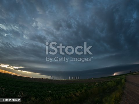 1039163636 istock photo Fisheye view of a supercell thunderstorm with mothership appearance over the high plains of Colorado, USA 1189570605