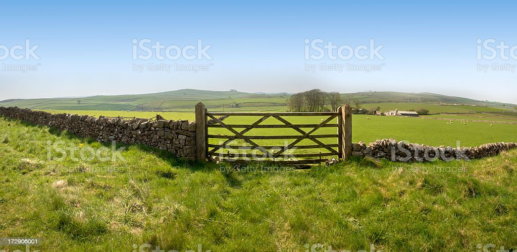Fish-eye view of an ancient stone farm fence with wide field stock photo