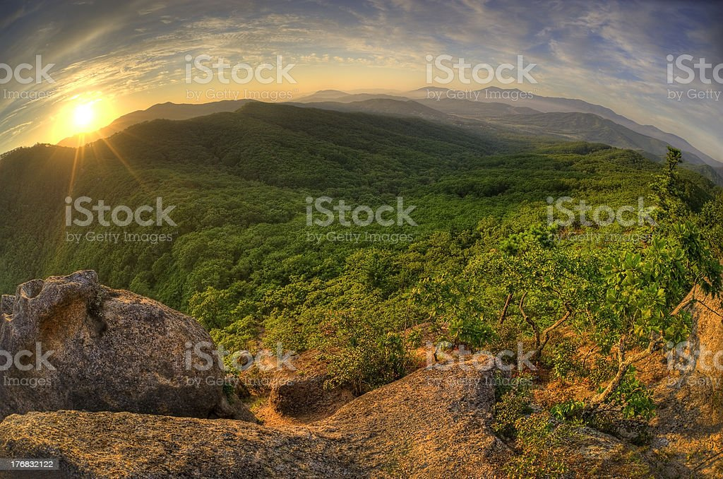 Fish-eye view of majestic sunset mountains landscape HDR image stock photo