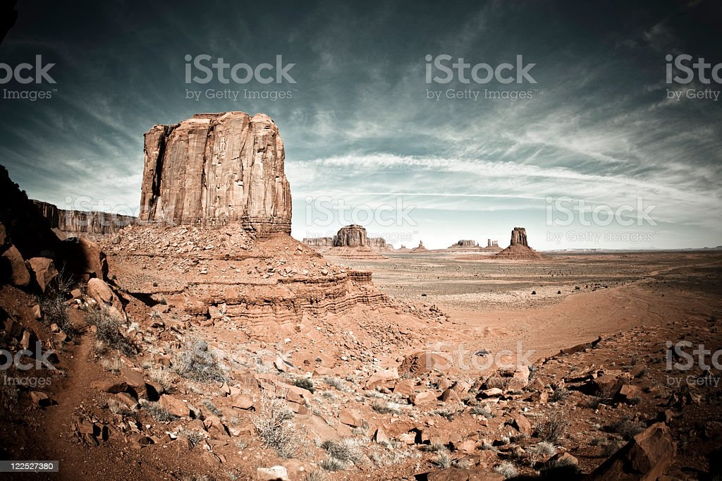 Fisheye view of monument valley with streaky clouds stock photo