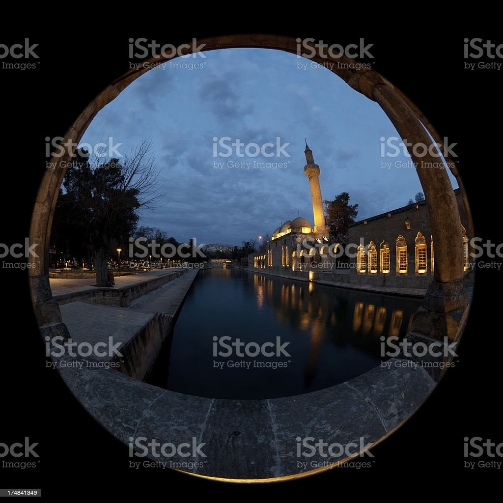 Fish-eye view of Rizvaniye Mosque and holy fish lake stock photo