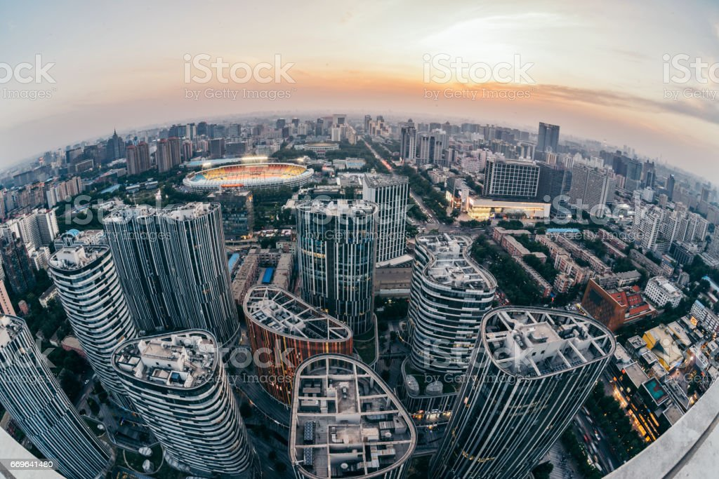 Fish-eye View of Sanlitun SOHO and Beijing City Urban Skyline at Sunset stock photo