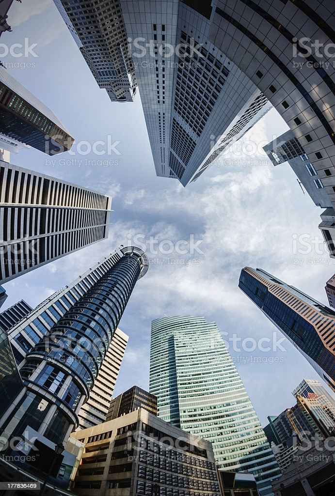 Fish-eye View of the Singapore Skyline Against a Blue Sky stock photo