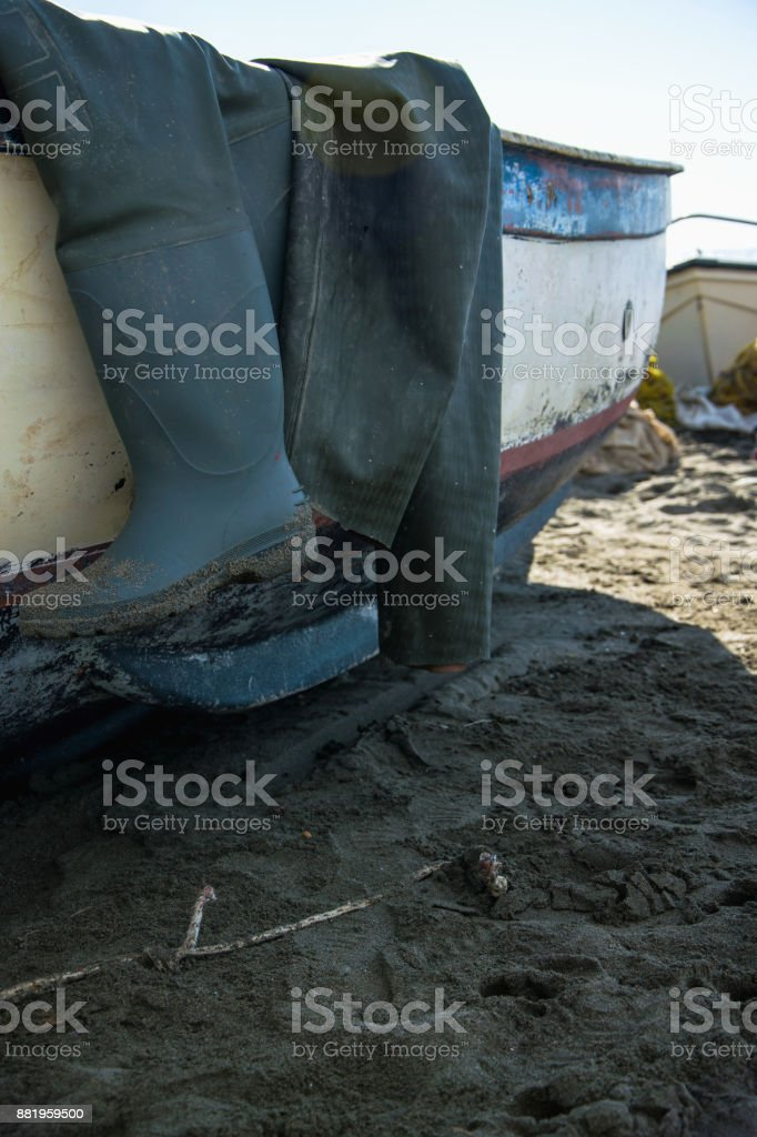 Fishimg boots on the boat stock photo