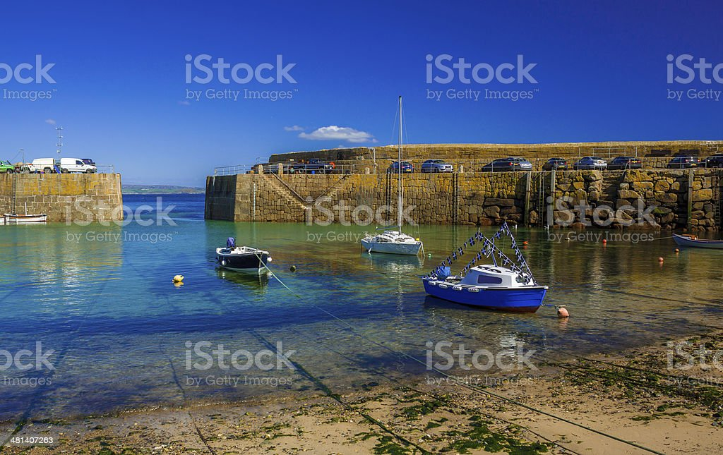 Fishing and leisure craft moored in Mousehole Harbour stock photo