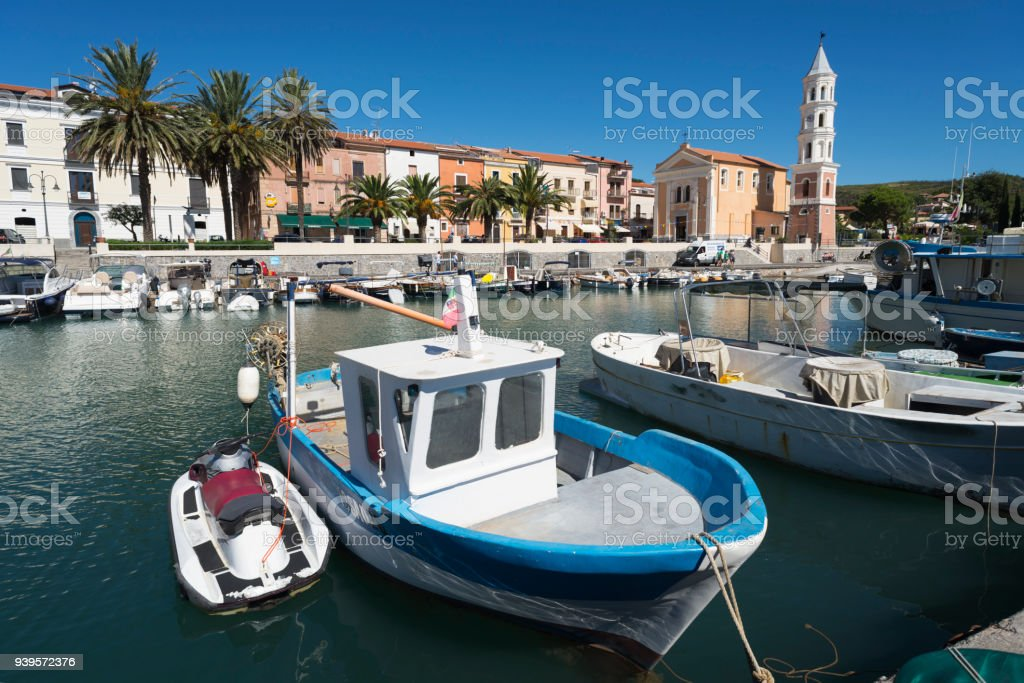 Fishing and motor boats in the picturesque harbor of Scario on the coast of the Mediterranean Sea in Cilento, Campania, Italy stock photo