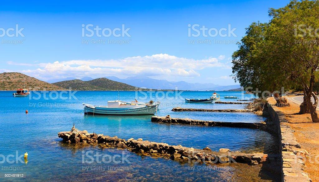 Fishing and pleasure boats off the coast of Crete. stock photo