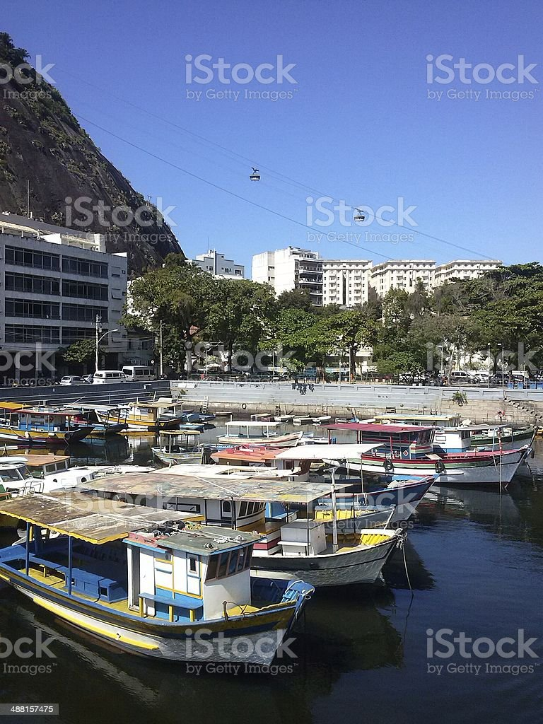 Fishing and tourism boats parked in public marina royalty-free stock photo