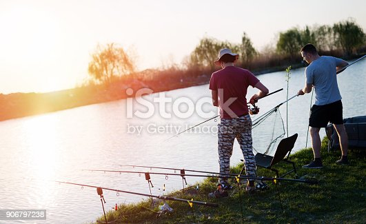 688562434istockphoto Fishing as recreation and sports displayed by fisherman at lake 906797238