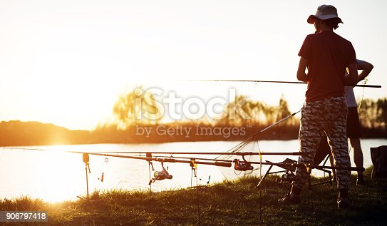688562434istockphoto Fishing as recreation and sports displayed by fisherman at lake 906797418