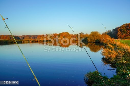 1094918172 istock photo Fishing at a rive run Germany 1080844910