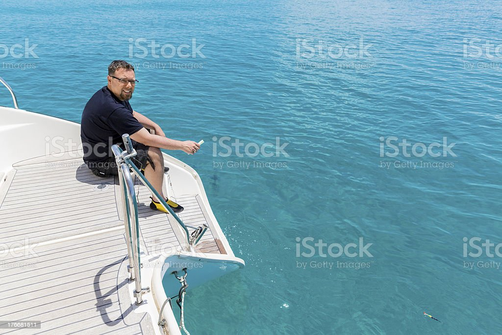 Fishing at beautiful blue sea royalty-free stock photo