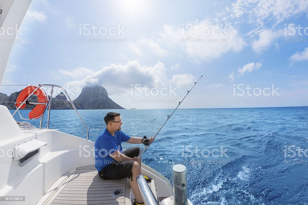 Fishing at beautiful blue sea stock photo