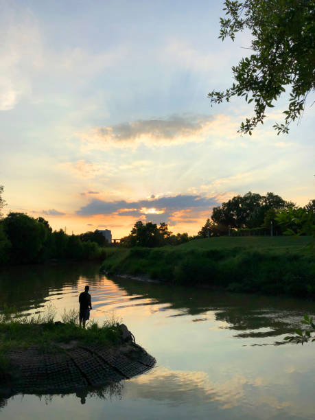Fishing at dusk stock photo
