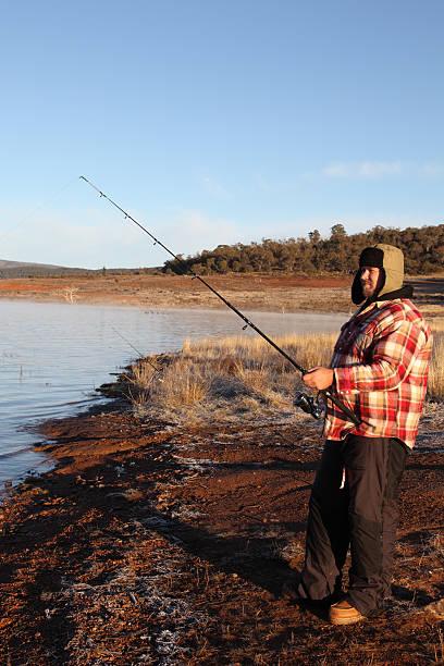 fishing at lake eucumbene, nsw australia - lake eucumbene stock photos and pictures
