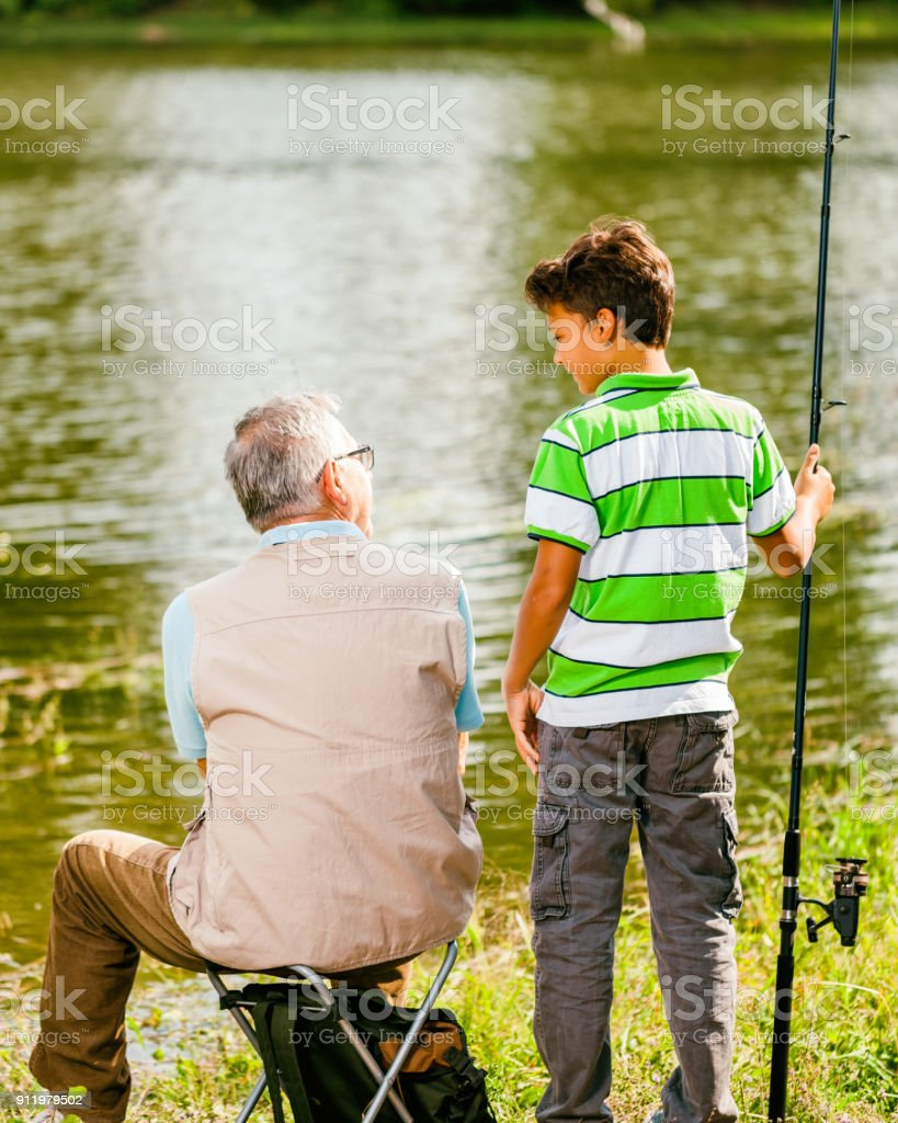 Fishing at river stock photo