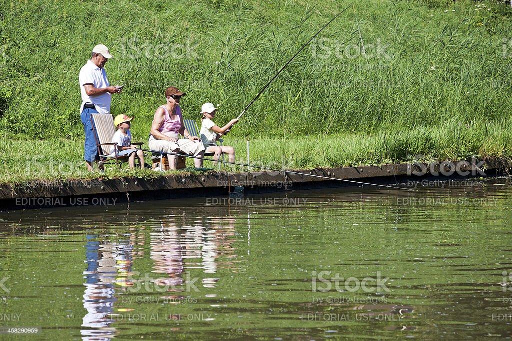 Fishing at riverside royalty-free stock photo