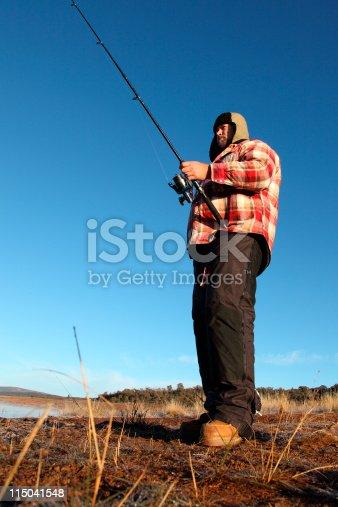 Lake fishing for trout on sunrise at Lake Eucumbene NSW Australia