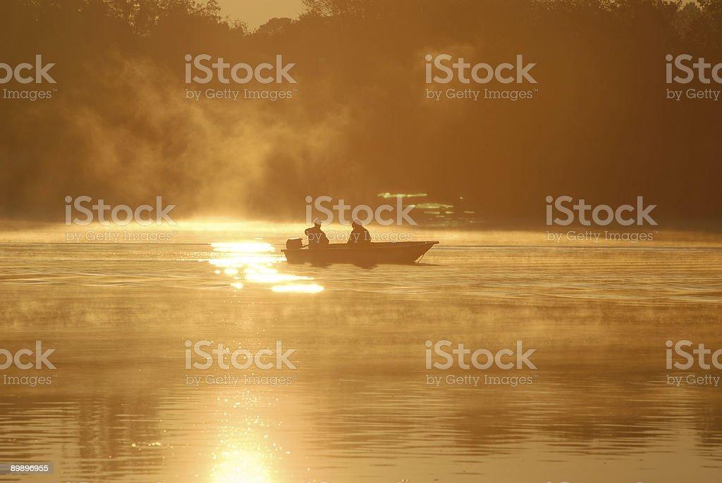 Fishing at sunrise royalty-free stock photo