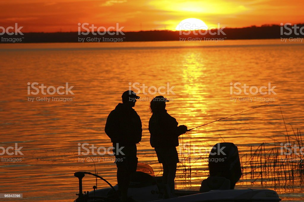 Fishing at Sunset 3 stock photo