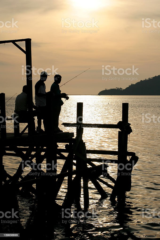 Fishing at Sunset in KK stock photo