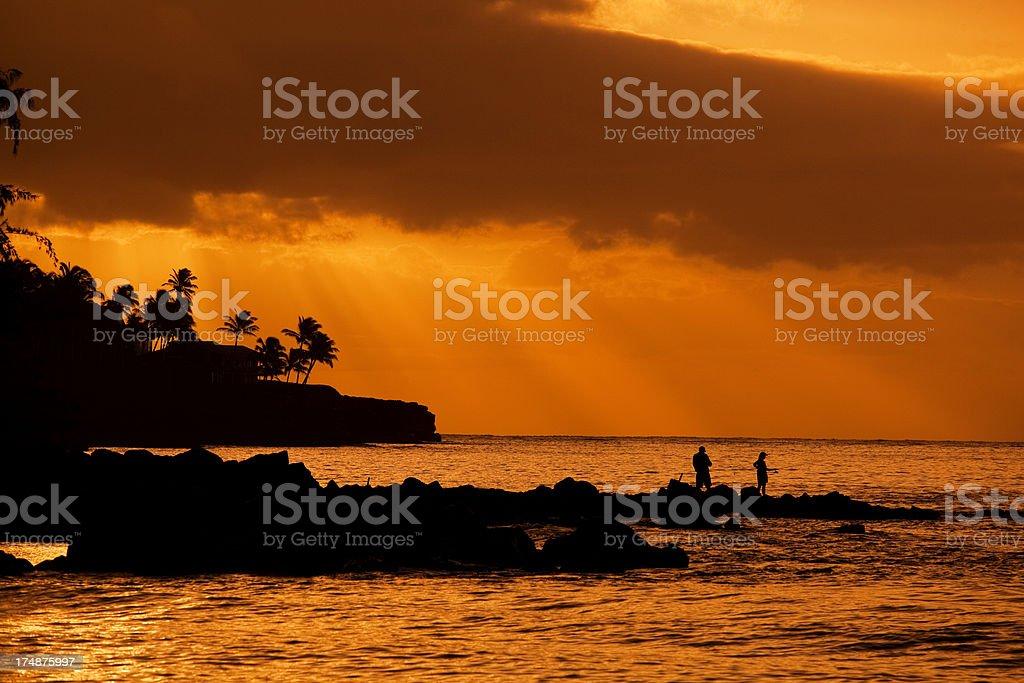 Fishing at Sunset in Poipu Beach Kauai Hawaii Horizontal royalty-free stock photo