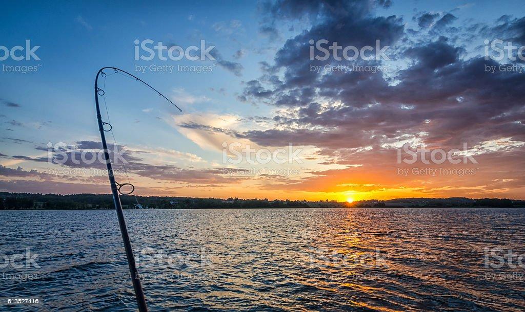 Angeln bei Sonnenuntergang  – Foto
