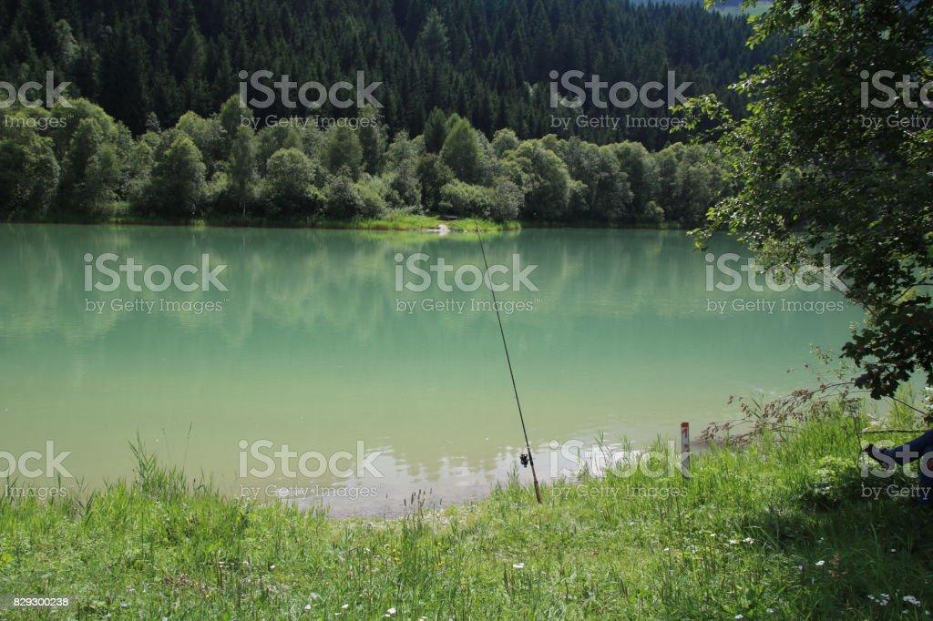 Fishing at Tassenbacher Speicher, Osttirol, Austria during Summer stock photo