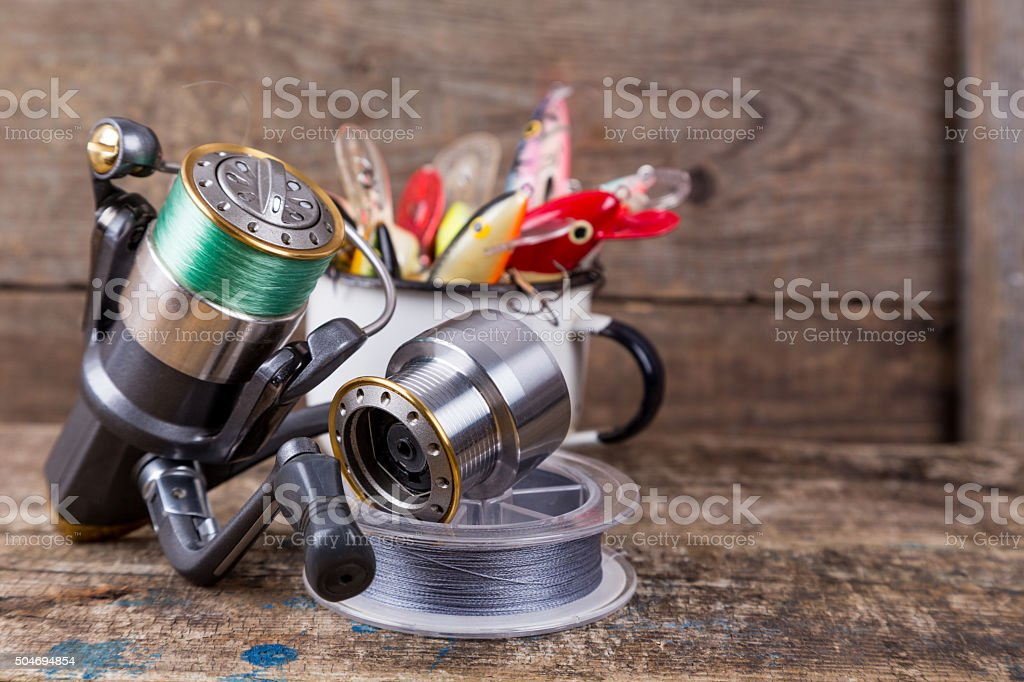fishing baits wobblers protrude from white metal cup stock photo