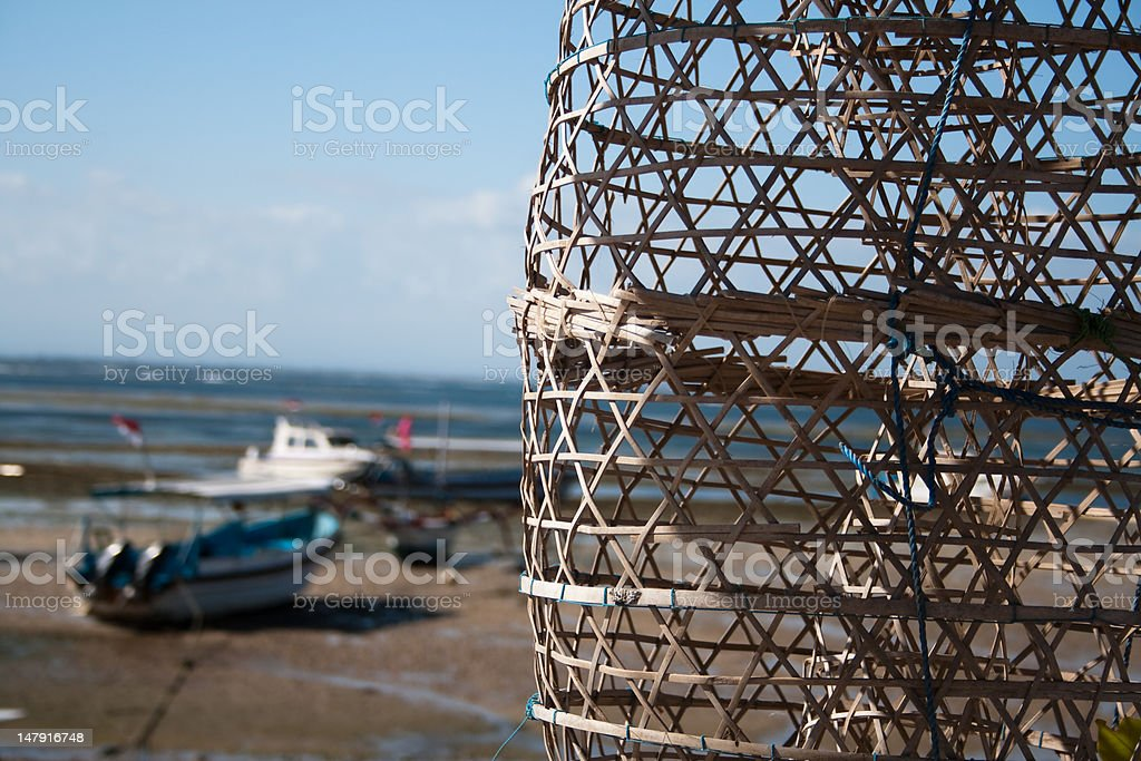 fishing  basket and boats on water's edge royalty-free stock photo